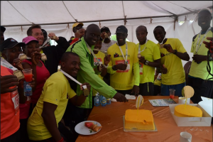 Proud finishers showing off their medals & cutting cake