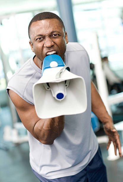 screaming trainer with a megaphone