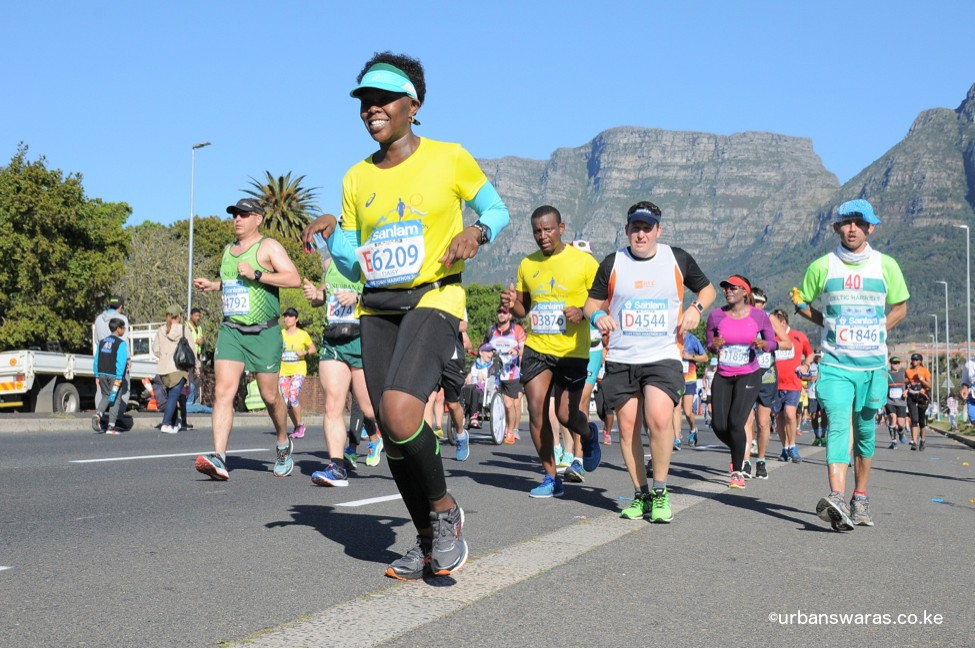 Beautiful run against backdrop of the Table Mountain (what hand pose is that?)